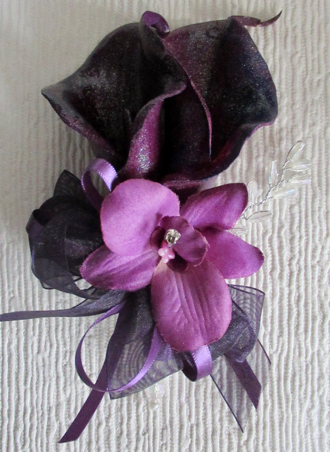 Plum pearlised Calla Lily Corsage