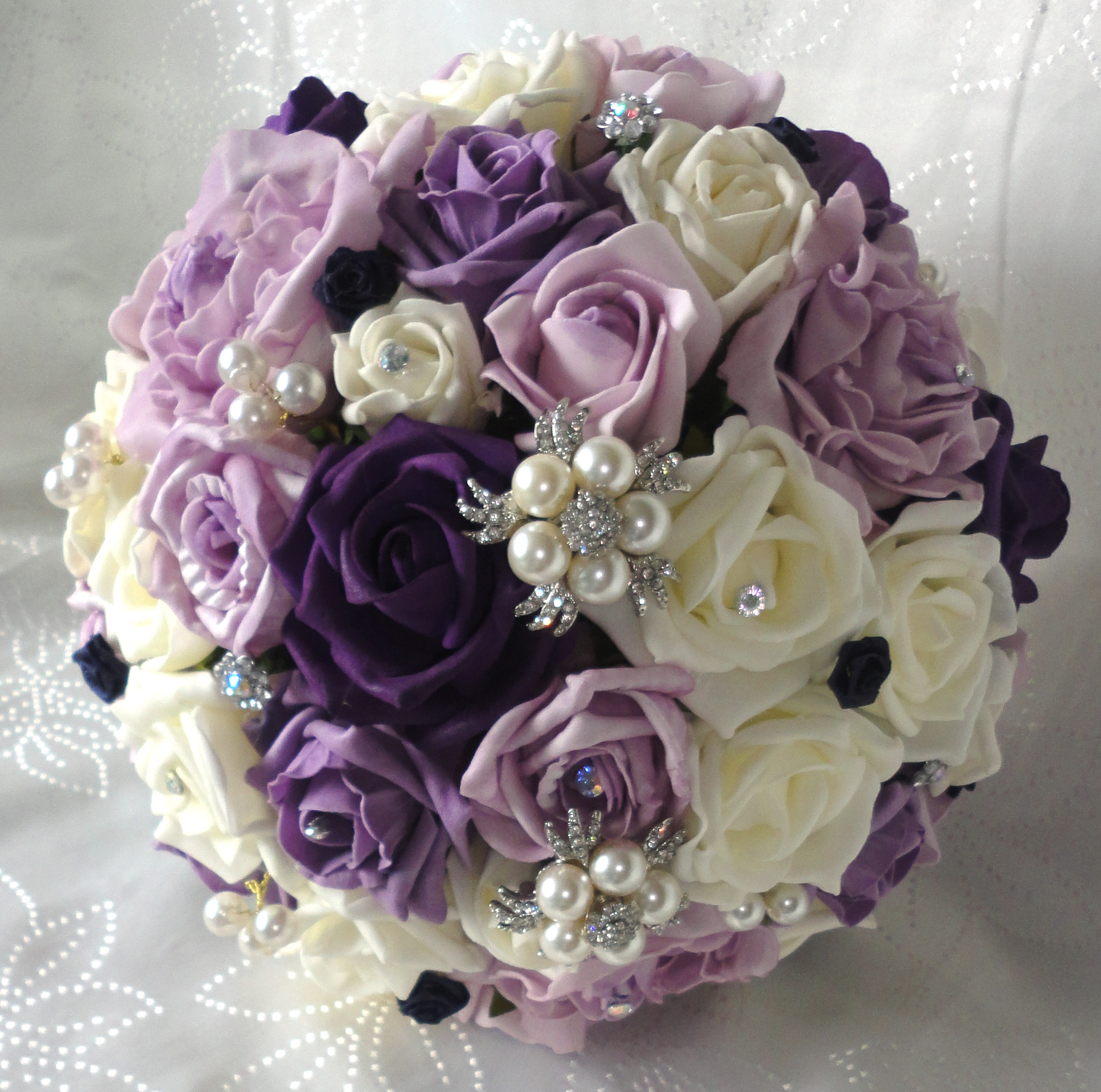 Purple silk wedding flowers images flower decoration ideas purple and ivory wedding flowers purple lisianthus and ivory roses image gallery ivory and lilac bouquet izmirmasajfo