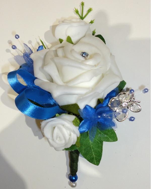 Blue & Ivory Rose Corsage now with a beautiful diamante butterfly