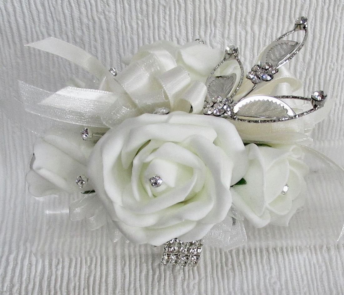 Pale ivory Roses with beautiful silver diamante leaf spray