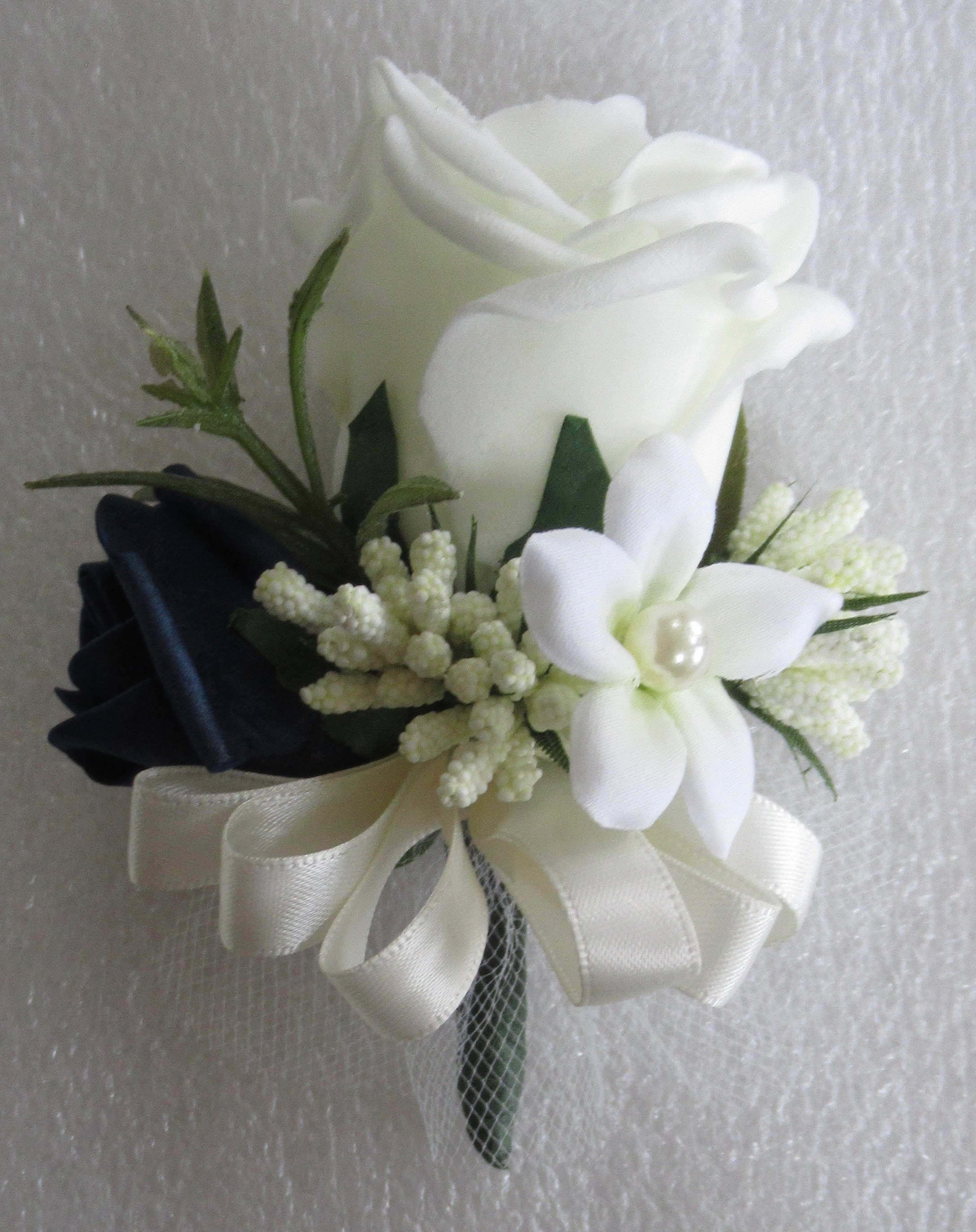 Ivory & Navy Blue Corsage with a pearled Stephanotis