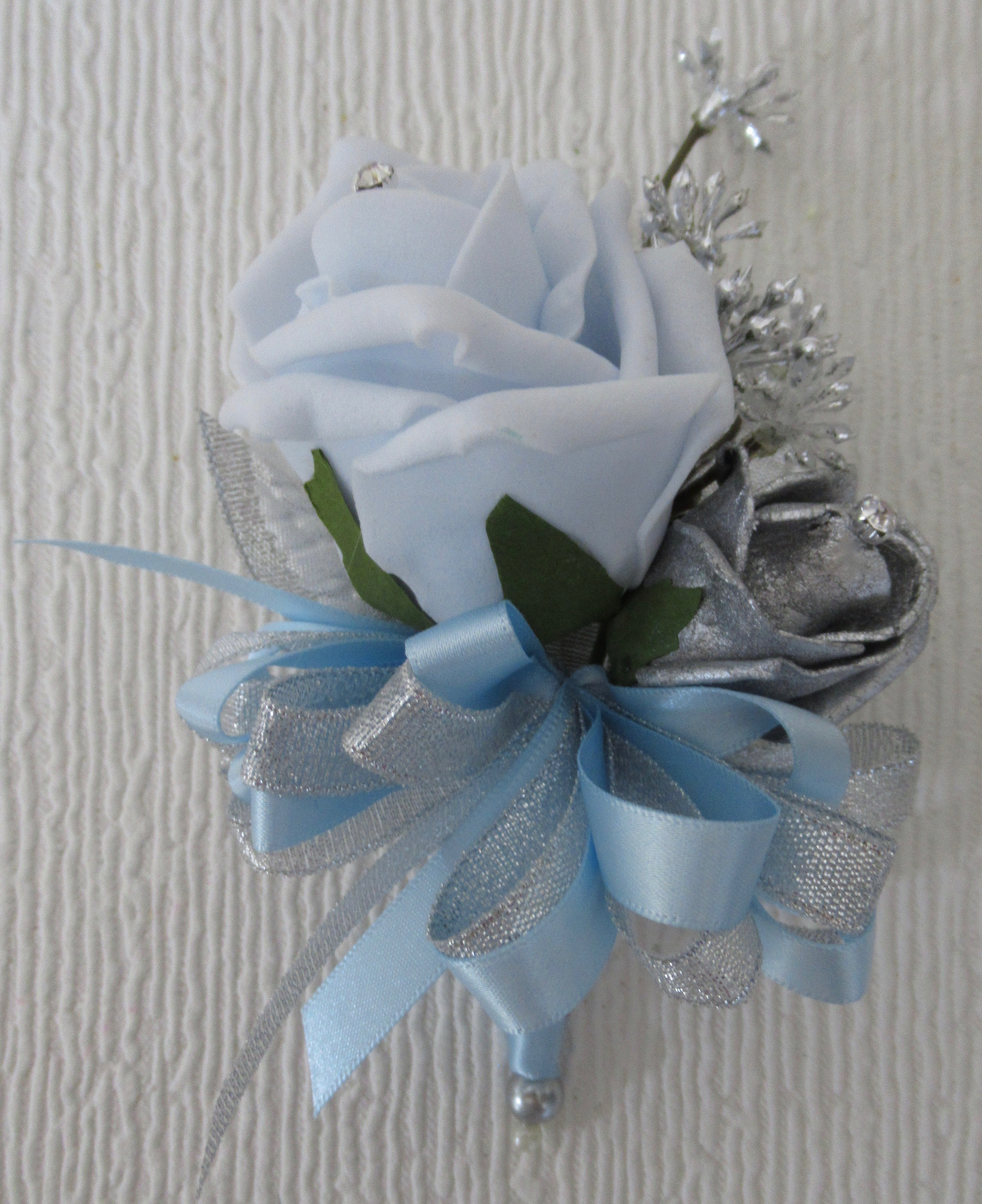 Ice blue rose & silver rose bud Corsage with silver mini berry spray