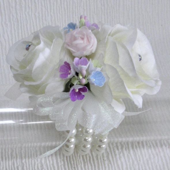Pale Ivory Roses with, pink, blue & Lilac forget me not Wrist Corsage