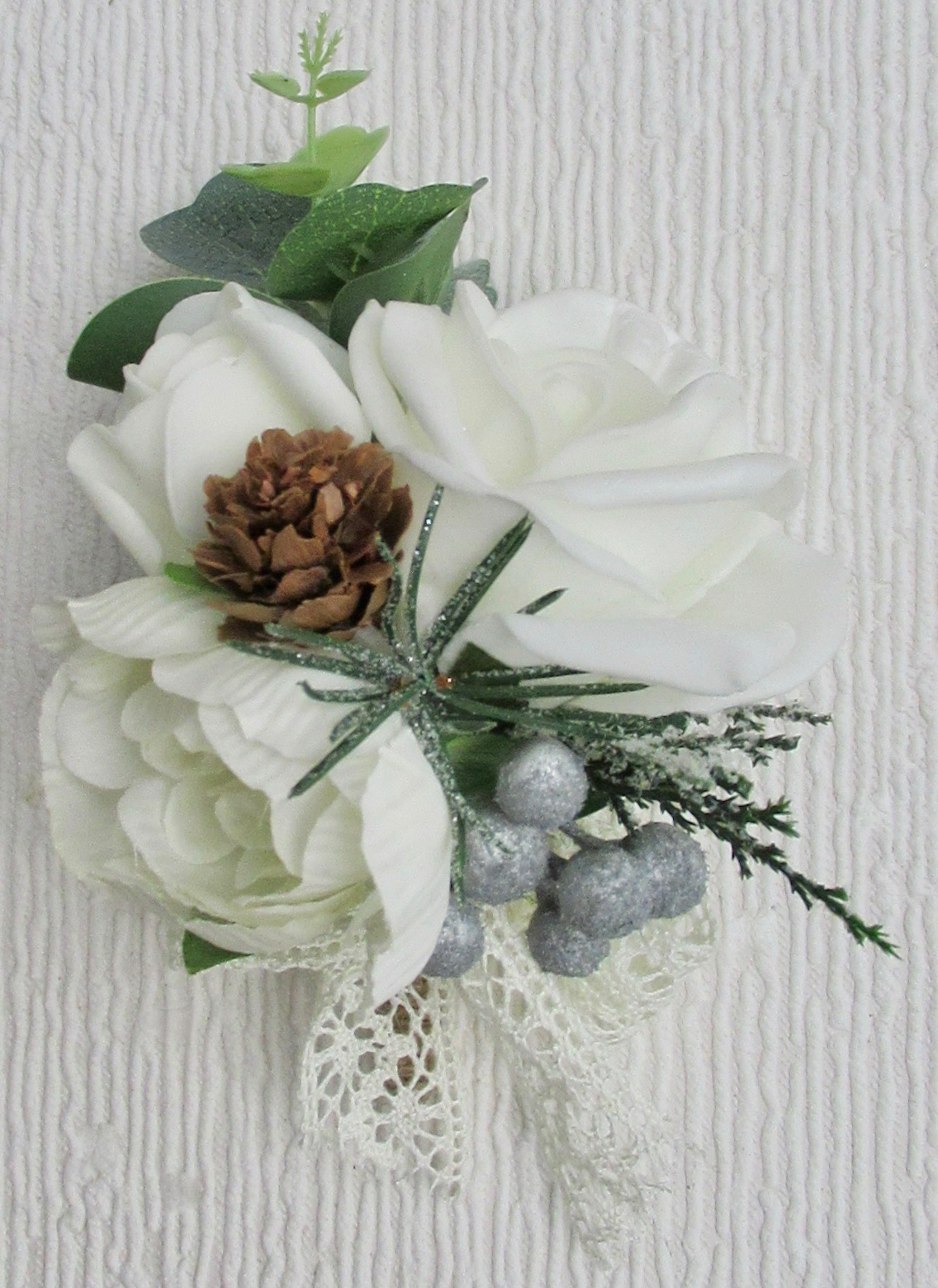 Corsage with Ivory Rose & Ranunculus with Mini Pine Cones